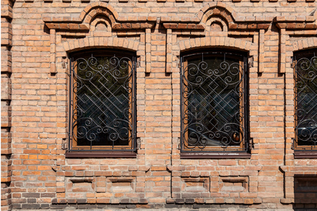 Close-up of a two  old windows  in old house a mansion made of old brick Stock Photo