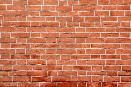 Red brick wall of an building, background texture of a brick