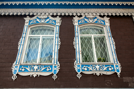 Close-up of a two old windows  in old house a mansion made of stone  brick Stock Photo
