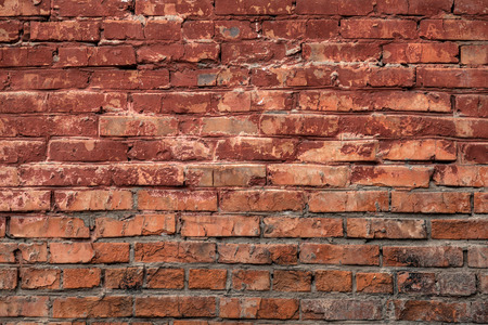 Red  old brick wall of an building, background texture of a brick Stock Photo