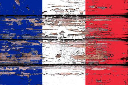 National flag of  France  on a dull wooden background