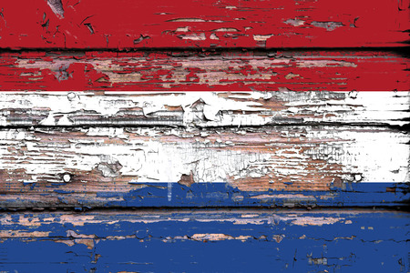 National flag of  Netherlands on a dull wooden background