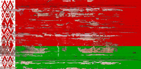 National flag of Belarus  on a dull wooden background