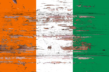 National flag of cote dIvoire on a dull wooden background