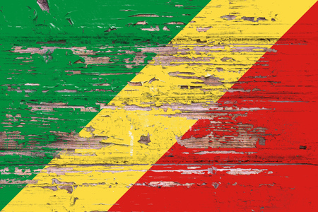 National flag of Republic of the Congo on a dull wooden background
