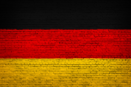 National flag of Germany on a brick background