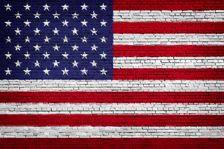 National flag of USA on a brick background 免版税图像