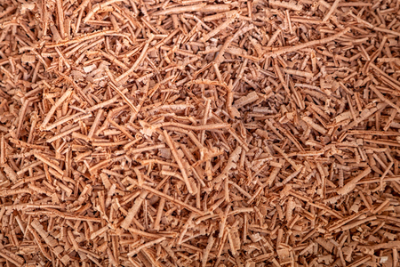 Close-up of wooden sawdust. Brown filings texture