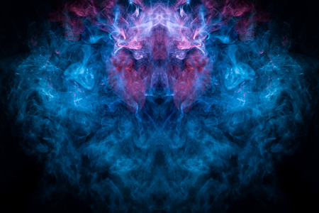 Pattern for cool t-shirts  Pink and blue  cloud smoke on black  isolated background in the form of a skull, monster, dragon on a black isolated background. Stock Photo