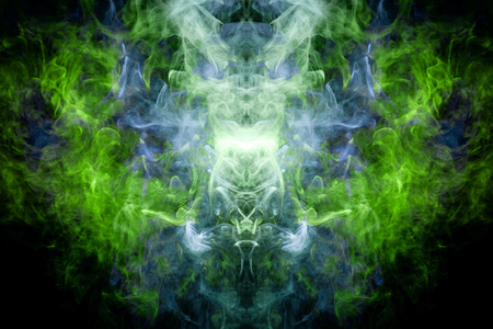 Fantasy print for clothes: t-shirts, sweatshirts. Thick colorful smoke of green, blue colors smoke in the form of a skull, monster, dragon on a black isolated background. Background from the smoke of vape