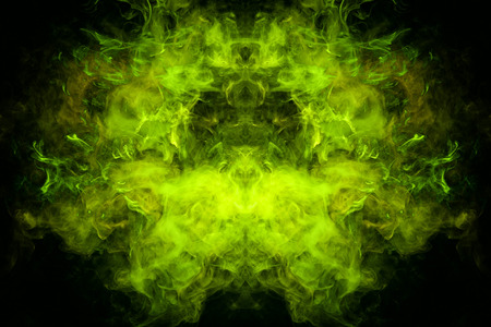 Fantasy print for clothes: t-shirts, sweatshirts. Green and yellow cloud of smoke in the form of a monster  of  black isolated background. Background from the smoke of vape.