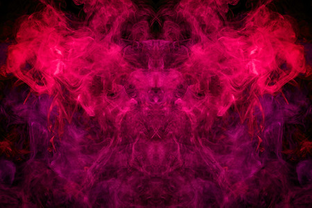 Fantasy print for clothes: t-shirts, sweatshirts. Thick colorful smoke of pink, red colors smoke in the form of a skull, monster, dragon on a black isolated background. Background from the smoke of vape