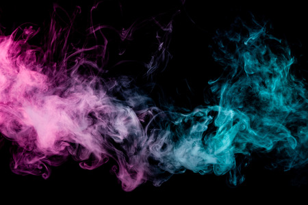 Textural background for creativity. Thick colorful smoke of pink, blue on a black isolated background. Background from the smoke of vape