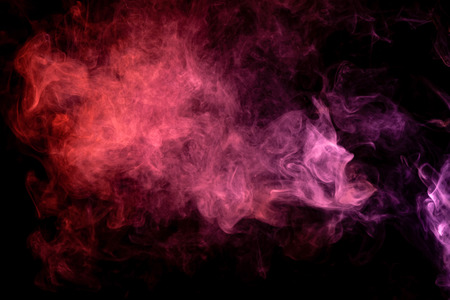 Textural background for creativity. Pink and red cloud of smoke of  black isolated background. Background from the smoke of vape
