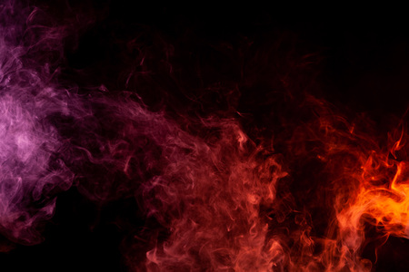 Textural background for creativity. Thick colorful smoke of pink, red on a black isolated background. Background from the smoke of vape