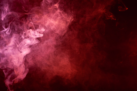 Textural background for creativity. Pink and red  cloud smoke on black  isolated background