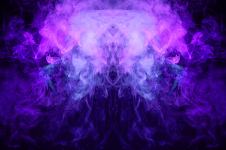 Fantasy print for clothes: t-shirts, sweatshirts. Purple and blue  cloud smoke  in the form of a skull, monster, dragon  on black  isolated background