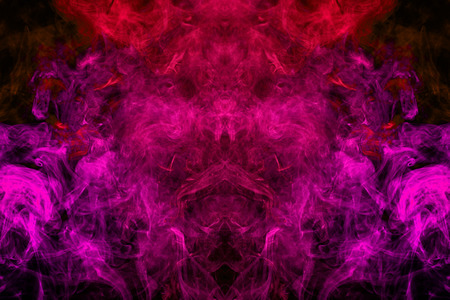 Fantasy print for clothes: t-shirts, sweatshirts.  Colorful pink and red smoke in the form of a skull, monster, dragon on a black isolated background. Background from the smoke of vape Stock Photo
