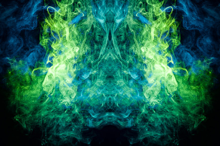 Fantasy print for clothes: t-shirts, sweatshirts. Thick green, blue smoke on a black isolated background. Fire flames background. Foto de archivo