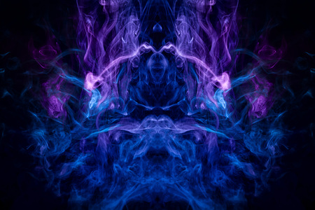 Mocap for cool t-shirts. Thick colorful blue and purple smoke  in the form of a monster on a black isolated background. Background from the smoke of vape.
