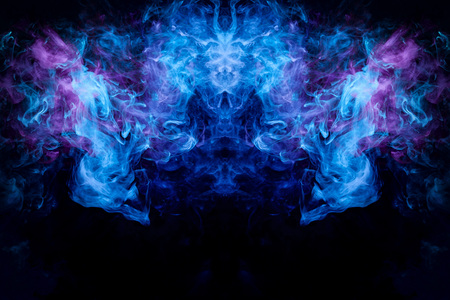 Fantasy print for clothes: t-shirts, sweatshirts.  Colorful blue and purple smoke in the form of a skull, monster, dragon on a black isolated background. Background from the smoke of vape Foto de archivo