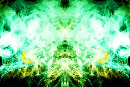 Dense yellow and green smoke on a black isolated background. Background of smoke vape