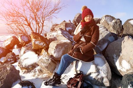 Winter young woman portrait. Beauty Joyful Model woman posing and laughing, having fun in winter park. Beautiful young woman laughing outdoors. Enjoying nature, wintertime Stock Photo