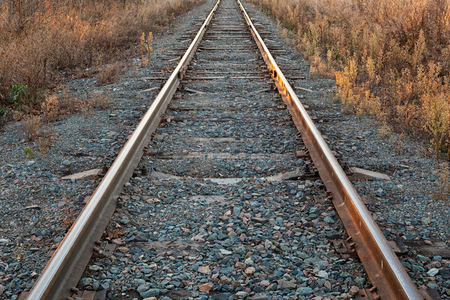 The Close-Up of the Straight Railway with Concrete Sleepers. Close-up of Railway Track