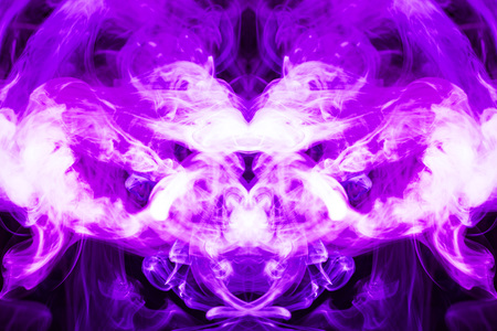Fantasy print for clothes: t-shirts, sweatshirts.  Colorful purple smoke in the form of a skull, monster, dragon on a black isolated background. Background from the smoke of vape Foto de archivo
