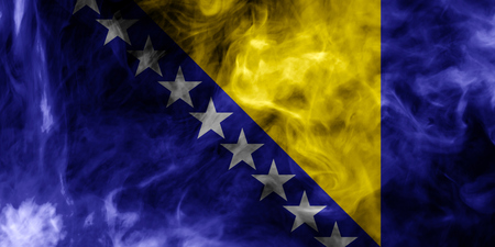 National flag of Bosnia Herzegovina from thick colored smoke on a black isolated background