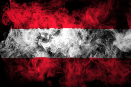 National flag of Austria from thick colored smoke on a black isolated background Reklamní fotografie