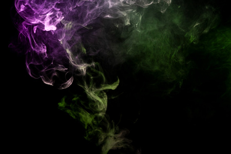 Thick pink and green smoke on a black isolated background. Background from the smoke of vape Stock fotó