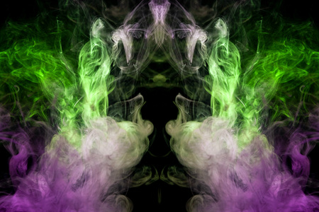 Fantasy print for clothes: t-shirts, sweatshirts.  Colorful pink and green smoke in the form of a skull, monster, dragon on a black isolated background. Background from the smoke of vape