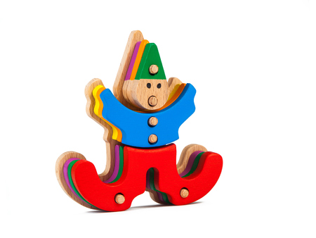 Photo of a wooden toy  children's clown sorter clown-shaped sorter from colorful pieces on a white isolated background. The toy for the development of fine motor child Foto de archivo