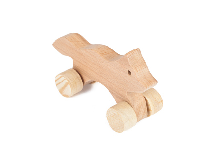 Photo of a wooden Fox on wheels of beech. Toy made of wood fox car on a white isolated background Archivio Fotografico