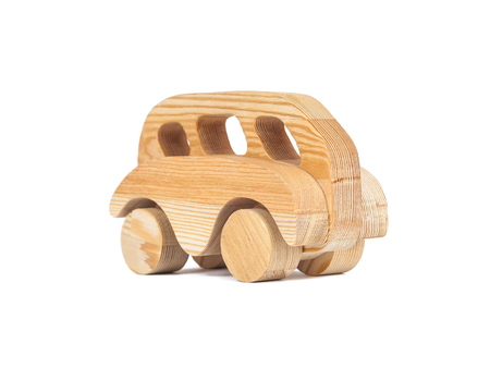 Photo of a wooden bus made of beech on a white isolated background