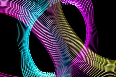 Abstract light blue, pink and yellow trails in random motion background image. Striped Neon Lights in Rainbow Colors Banco de Imagens