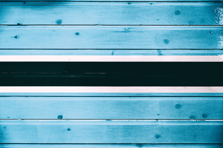 National flag of Botswana  on a  wooden background