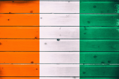 National flag of cote dIvoire on a wooden background