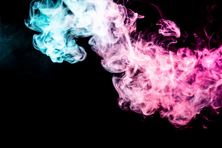 Cloud of pink and blue smoke on a black isolated background. Background from the smoke of vape Stock Photo