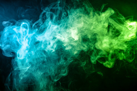 Blue and green bomb smoke on black isolated  background