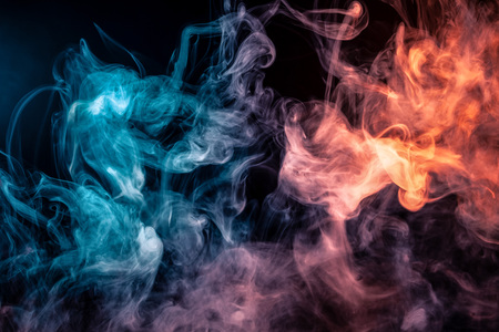 Blue and red bomb smoke on black isolated  background