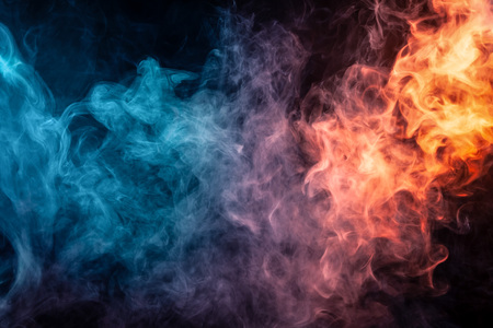 Abstract art colored smoke red and blue on black isolated background. Stop the movement of multicolored smoke on dark background Stock Photo