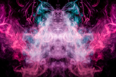 Dense multicolored smoke of   blue and purple colors in the form of a skull, monster, dragon on a black isolated background. Background of smoke vape. Mocap for cool t-shirts Stock Photo