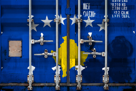 Close-up of the container with the national flag of Kosovo. The concept of Kosovo  export-import and national delivery of goods.