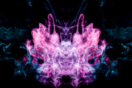 Cloud of blue and pink smoke  in the form of a skull, monster, dragon  on a black isolated background. Background from the smoke of vape. Mocap for cool t-shirts Stock Photo