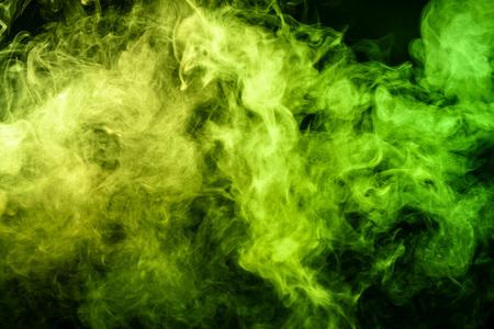 Green  bomb smoke on black isolated  background