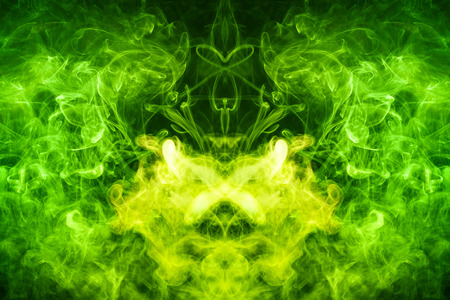 Mocap for cool t-shirts. Thick colorful green smoke  in the form of a monster on a black isolated background. Background from the smoke of vape. Stock Photo