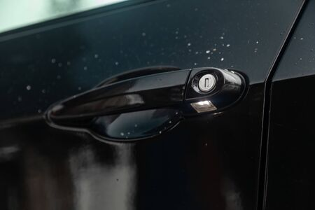 Novosibirsk, Russia - February 16, 2019:  BMW X5,close-up of the door handle with lock. Photography of a modern car on a parking in Novosibirsk Standard-Bild - 133071862