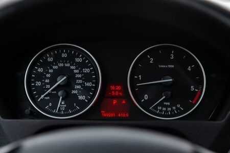 Novosibirsk, Russia - February 16, 2019:  BMW X5,close-up of the dashboard, speedometer and tachometer. Photography of a modern car on a parking in Novosibirsk Standard-Bild - 133071863